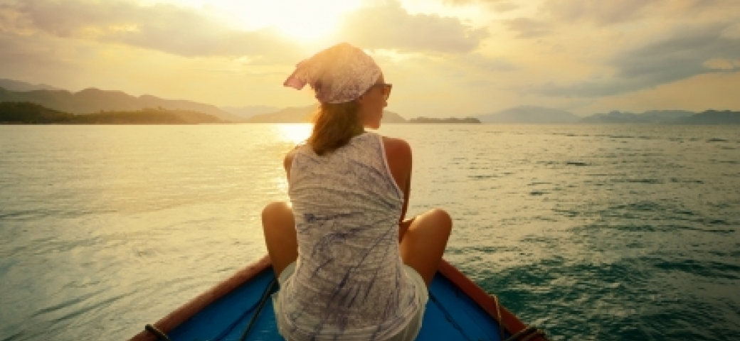 woman sitting on boat looking contemplative