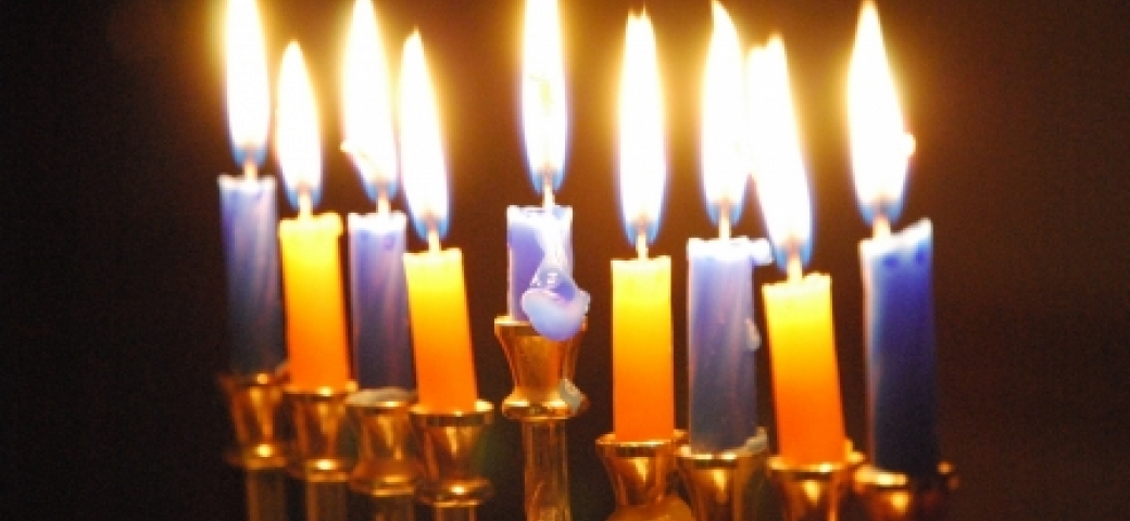 hanukkah candles lit in the darkness