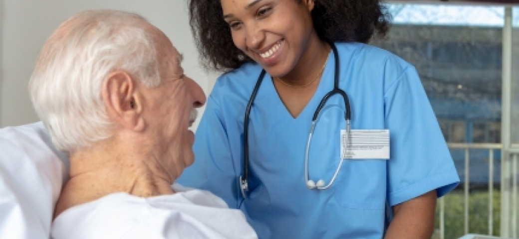 nurse smiling at elderly patient