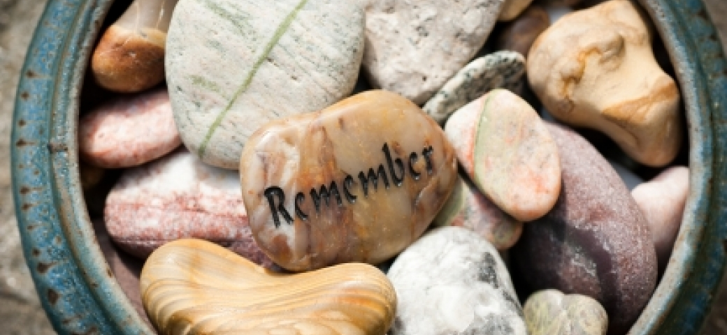 stone that says the word remember surrounded by other stones