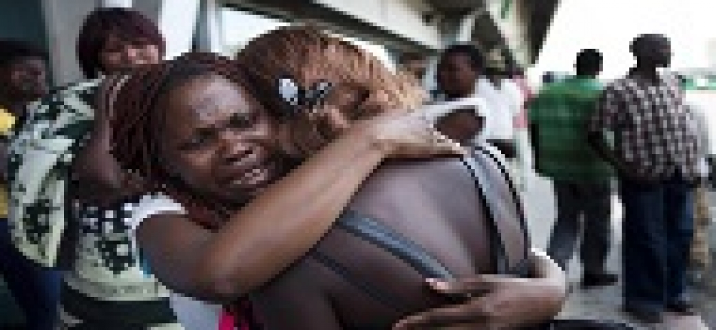 two black women hugging and crying