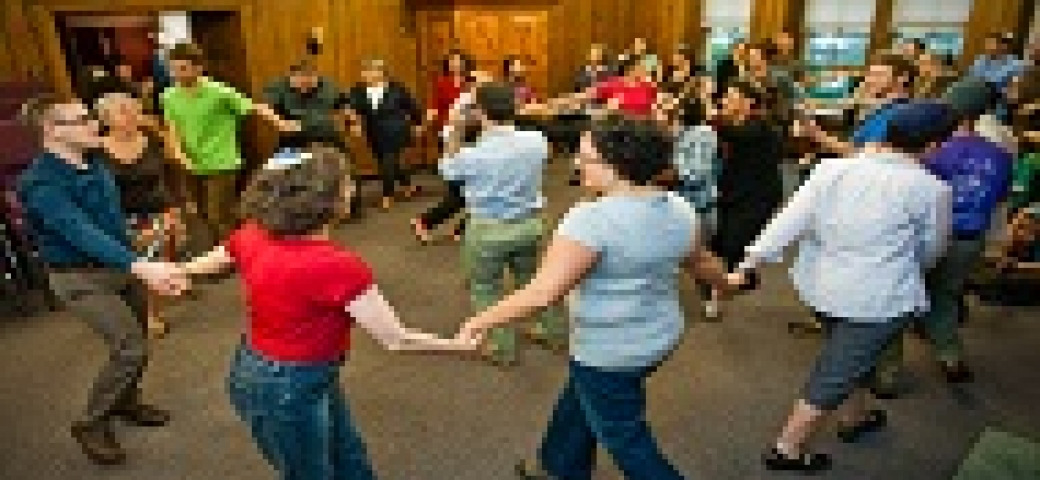people dancing holding hands in a circle
