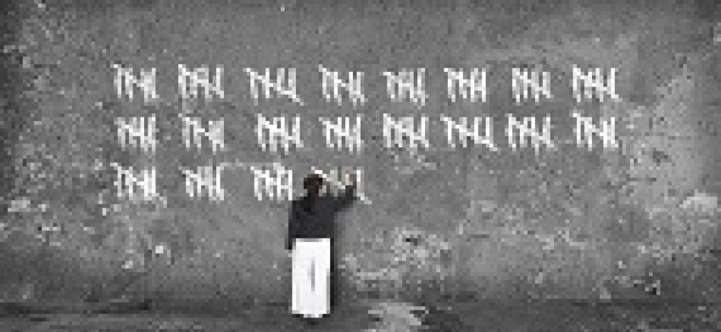 woman making counting slash marks on a supersize chalkboard