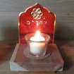candle holder with floral symbol and word l'haim
