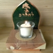 candle holder with a flame background, tree and word l'haim