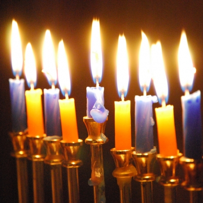 close up of glowing hanukkah candles