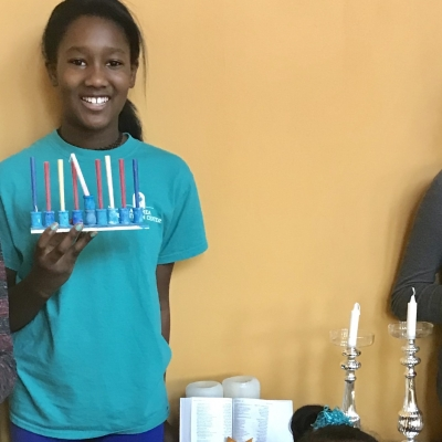 children holding hanukkah menorahs