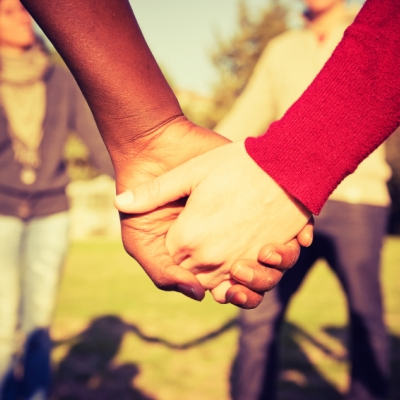 people of different races holding hands