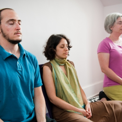 three people meditating