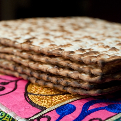 stack of matzot on colorful fabric