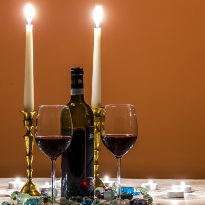 shabbat candles, bottle of wine and two glasses of wine