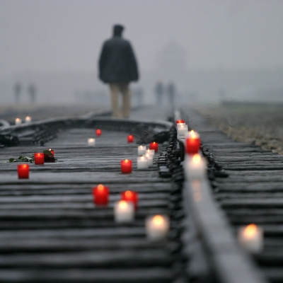 candles on train tracks man walking in the distance