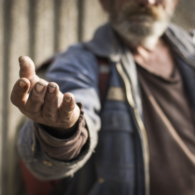 person with outstretched hand