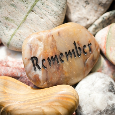stones with one that reads remember