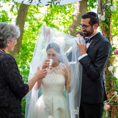 rabbi miriam liebman and groom getting married under the huppah