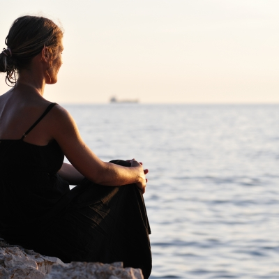 woman looking out at sea