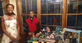 Tarece Johnson's children celebrating Kwanzakkah with symbols from both traditions