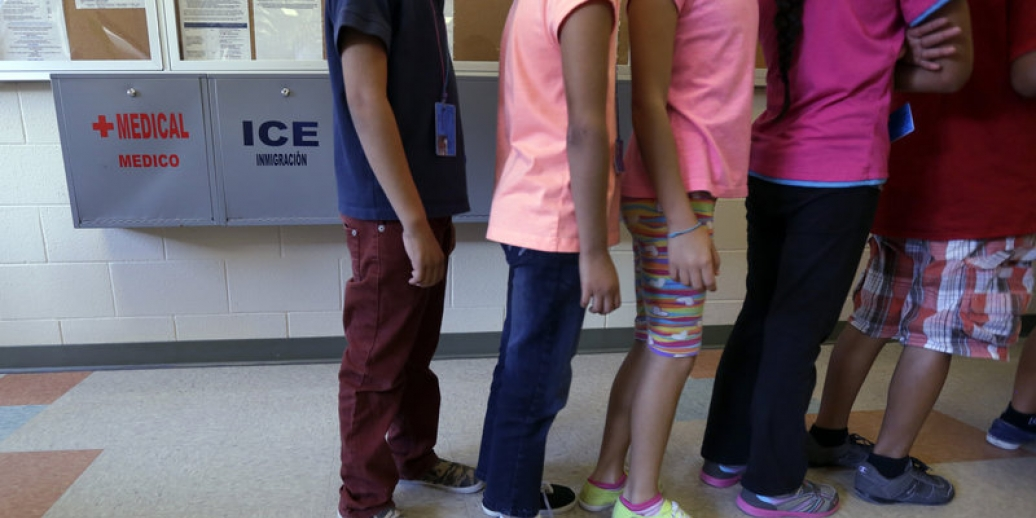 Detained immigrant children line up in the cafeteria at a temporary home for immigrant women and children detained at the border, in Karnes City, Texas. Eric Gay/AP
