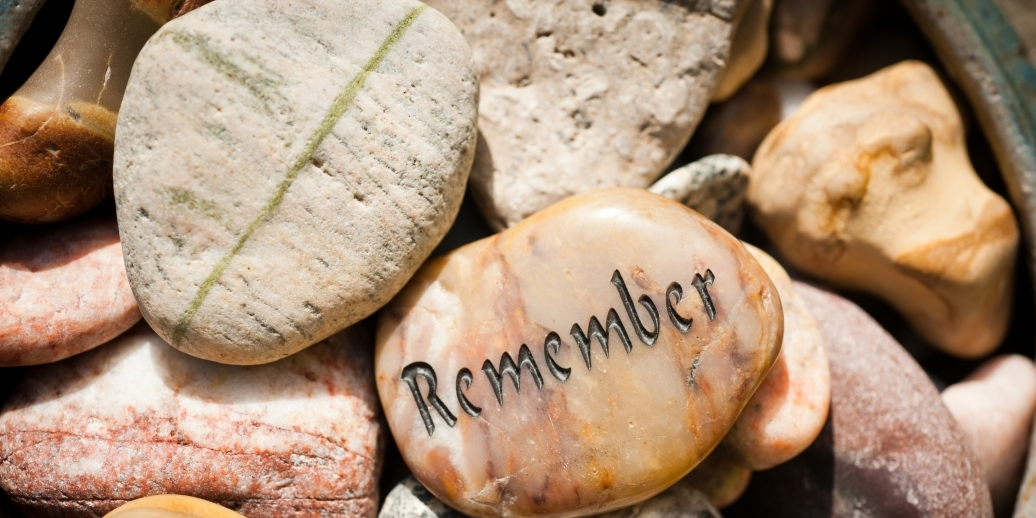 group of stones, one of which shows the word Remember