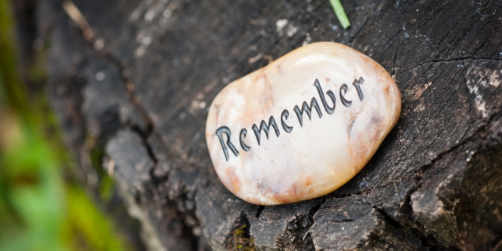 stone that reads the word remember
