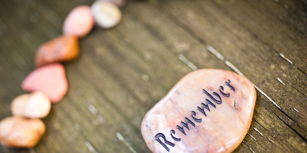 stone that says remember surrounded by other stones