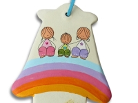 clay hamsa with two cartoon adults and child sitting on a rainbow